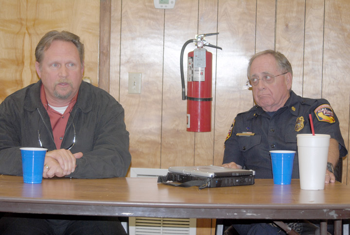 At last week's County Service Area 38 Advisory Committee meeting, Bruce Barton (left), director of Riverside County's Emergency Medical Agency, and John Hawkins, chief of the Riverside County Fire Department, discuss the changes in ambulance service for the Pine Cove area starting July 1. Photo by J.P. Crumrine