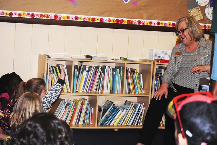 "Susan Righetti, from the Idyllwild Library, describes the duties of a librarian Tuesday to the children at Town Hall, during ""What do you want to be when you grow up?"" Week (spring break from school). Photo by J.P. Crumrine"
