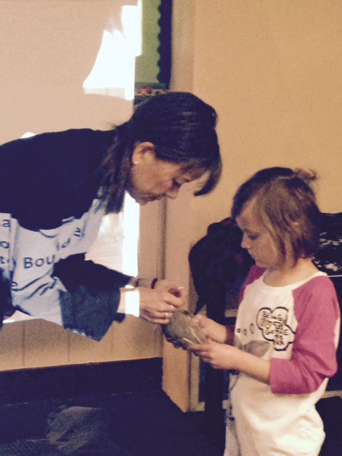 Dr. Jennifer Gee, of the James Reserve, shows a quail to Evelyn Johnson during spring break at Town Hall. Photo by Wendy Watts