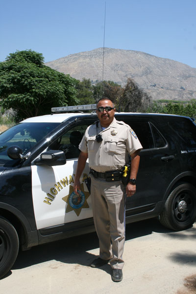 Officer Dario Cruz, one of the California Highway Patrol officers involved with the weekend surveillance of highways 243 and 74 targeting motorcycle infractions. Photo by Marshall Smith