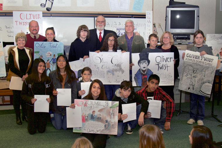 Idyllwild School Charles Dickens Essay and Poster Contest were announced Tuesday morning. The contest, in its eleventh year, is sponsored by Mary Austin Scholarships and Grants. Some $550 in cash prizes were awarded. Pictured here from top row left: Suzy Caparelli, Matt Kraemer, Marina Khella, Matt Hamlet, Doug Austin, Sophia Holanda, George Companiott, Vinny Parillo, Donna Mercer and Sierra Barnett; bottom row from left: Sidney Cruz, Abby See, Parker Strunk, Arriana Felix, Zack Zambranao and Izaiah Carmen. Photo by John Drake