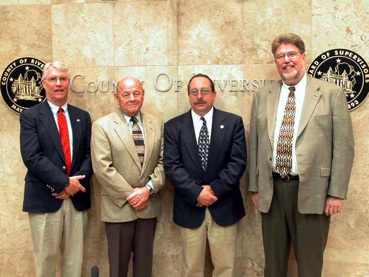 After the August 19, 2003, Riverside County Board of Supervisors meeting, the principals, who were involved in requesting the county's transfer of $500,000 to the Idyllwild Fire Protection District in order to acquire a ladder truck, posed outside the Board room. From left are Idyllwild Fire Chief Tim Gustafson, 3rd District Supervisor Jim Venable, Idyllwild Assistant Fire Chief Mike Norris and Idyllwild Arts Headmaster Bill Lowman. IFPD is now considering selling or trading the ladder truck. File photo