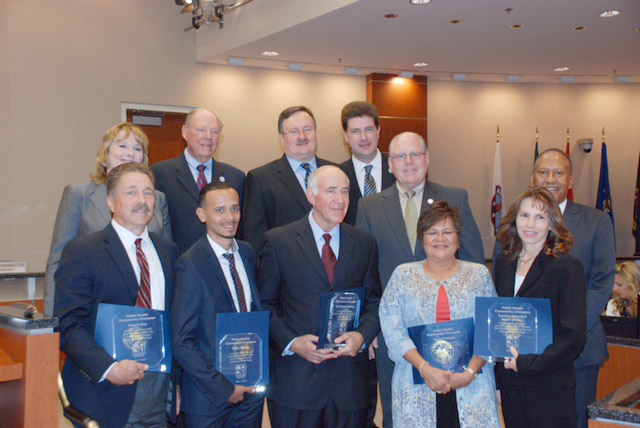 Idyllwild's Dr. Richard Goldberg (front center) was recognized at the third-annual Public Health Community Champion Awards last week. Goldberg represented the 3rd Supervisorial District. The other awardees were (front row, from left) Robert Roy, Gabriel Maldonado, Aurora Wilson and Melanie Nieman. Also shown in the back row (from left) are Susan Harrington, director of the Department of Public Health; 5th District Supervisor Marion Ashley; 1st District Supervisor Kevin Jeffries; Dr. Cameron Kaiser, the county Public Health officer; 4th District Supervisor John Benoit; and 3rd District Supervisor Chuck Washington. Photo by Robert Cipriani, Riverside County
