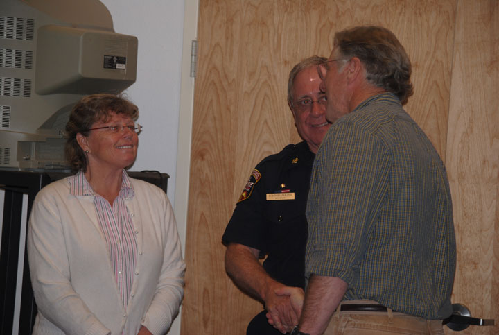 After Saturday's community meeting on the Goldspotted oak borer, Kathleen Edwards, former Cal Fire staff, discusses the situation in Idyllwild with John Hawkins (center), Riverside County fire chief, and Dr. Tom Scott of the University of California, Riverside. Photo by J. P. Crumrine
