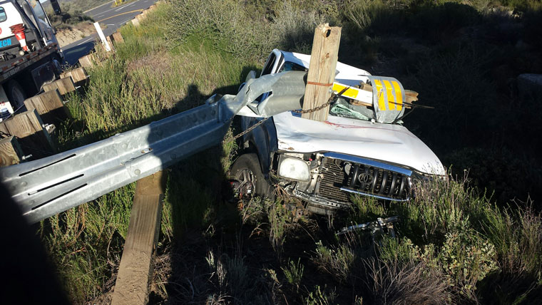 A Toyota truck with two occupants struck the guardrail at mile marker 57.30 on Highway 74 on the upper passing lanes before Mountain Center Tuesday morning. The vehicle went 10 feet over the side. Both parties were transported for medical care with minor injuries reported.Photo by Dan Crabtree
