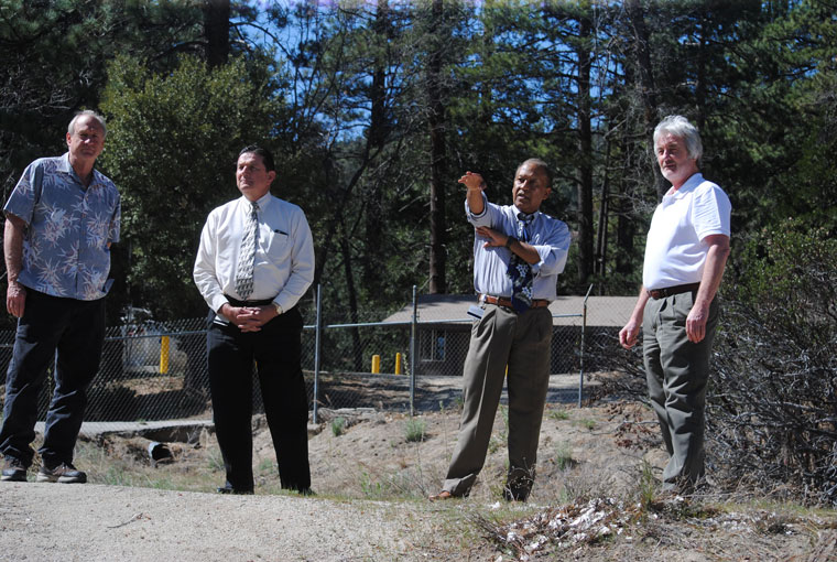 On Monday, 3rd District Supervisor Chuck Washington (second from right) toured the Idyllwild Water District facilities. He, Jim Billman (left), IWD board president, Verne Lauritzen (second from left), Washington's chief of staff, and Tom Lynch (right), IWD general manager, look at a dry Foster Lake. Photos by J.P. Crumrine