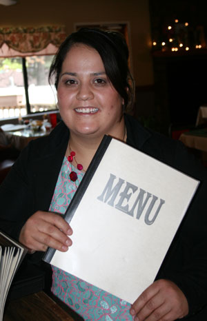 Carol Martinez, new co-owner, along with husband Juan, of Arribas Mexican Restaurant. Photo by Marshall Smith