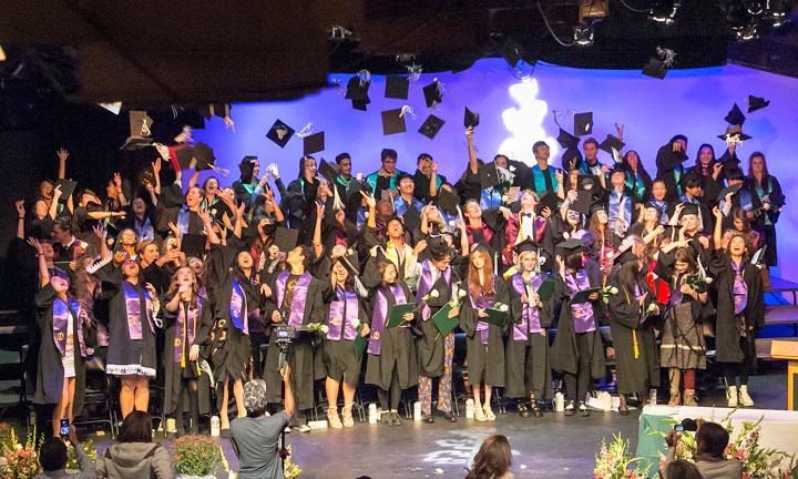 The Idyllwild Arts Academy class of 2015 celebrates after they receive their diplomas and turn their tassels. For the first time in history, the school's senior graduation was moved into IAF Theatre due to inclement weather on Saturday morning. Photo by Jenny Kirchner