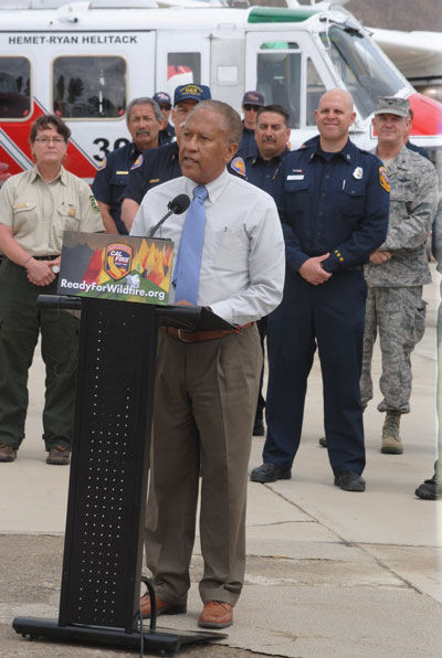 Riverside County 3rd District Supervisor Chuck Washington speaking during Friday's Wildfire Awareness Week event at Ryan Air Attack Base in Hemet. In the back are fire officials from the U.S. Forest Service, the state Office of Emergency Services, Cal Fire and the National Guard.Photo by J.P. Crumrine