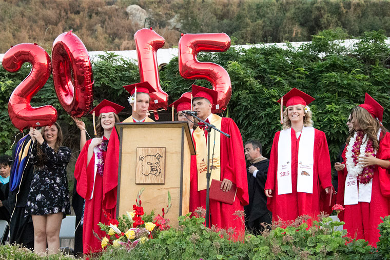 Hemet High's 2015 Senior Class officers take the stage and prepare to switch their tassels from right to left and release the 2015 balloons as they officially graduate high school last Thursday. Chad Schelly (left of podium), of Idyllwild, was the 2015 Class Representative. Photo by Jenny Kirchner