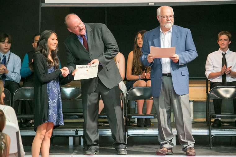 Class Valedictorian Abby See receives her promotion certificate from Principal Matt Kraemer Wednesday during the Idyllwild School promotion at the school. Hemet Unified School District Trustee Vic Scavarda (standing right) participated in the promotion ceremony.