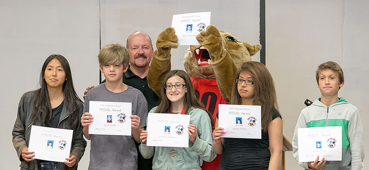 "Principal Matt Kraemer poses with the six eighth-grade students recognized as ""hillbillies"" — attending Idyllwild School from kindergarten through eighth grade. They are (from left, in front) Abby See, Rylan Hardy, Carolyn Edelstein, Jessica Chavez, Vinny Parillo and ""Rocky"" (Zack Zambrana, next to Mr. Kraemer)."