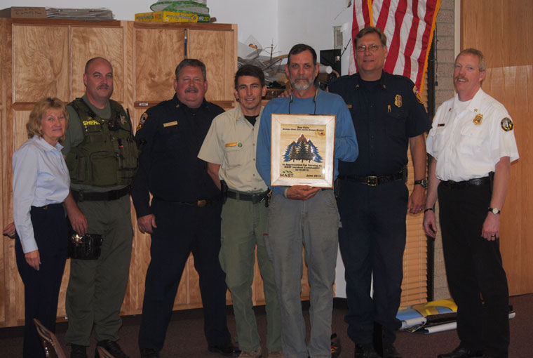Mountain Area Safety Taskforce officials honored retired Forest Service San Jacinto District Fire Manager Dan Felix (center, holding plaque) at last week's meeting. From left are Edwina Scott, executive director of the Mountain Communities Fire Safe Council; Frank James, Riverside County Sheriff's deputy; Gregg Bratcher, Riverside County Fire Department Mountain Unit forester; Freddie Espinoza, current San Jacinto District fire manager; Bill Weiser, RCFD Mountain Division chief; and Patrick Reitz, Idyllwild Fire chief. Photo by J.P. Crumrine