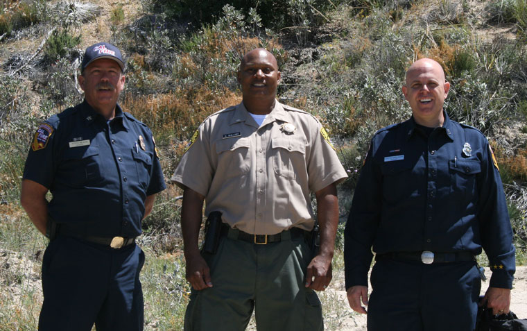 From left, Cal Fire Division Chief Steven Beach, Oak Glen Conservation Camp Commander Keith T. Guillory (center) and Cal Fire Captain and Public Information Officer Lucas Spelman on site at the Poppet Flat Truck Trail project. Photo by Marshall Smith