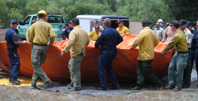 Since Foster Lake is empty, last week in Dutch Flats, fire agencies set up the pumpkin that holds 15,000 gallons of water as an emergency water source in case of fires. Photo by J.P. Crumrine