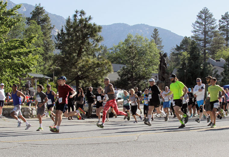 The 10K run begins with a burst of racers. Photo by John Drake