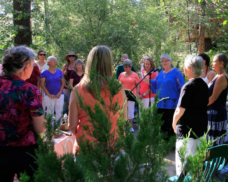 Director Mary Morse shares thoughts on the Summer Solstice with other locals gathered at the Spirit Mountain Retreat on Sunday.Photo by John Drake