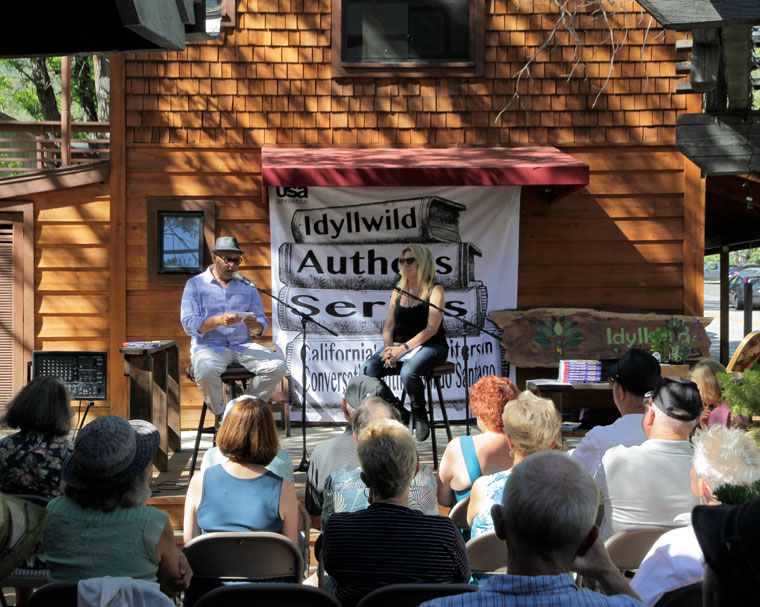 """Eduardo Santiago interviews author Deanne Stillman about her book """"Twenty-Nine Palms"""" in the fifth-annual Idyllwild Authors Series at Cafe Aroma last Sunday. Photo by John Drake"""
