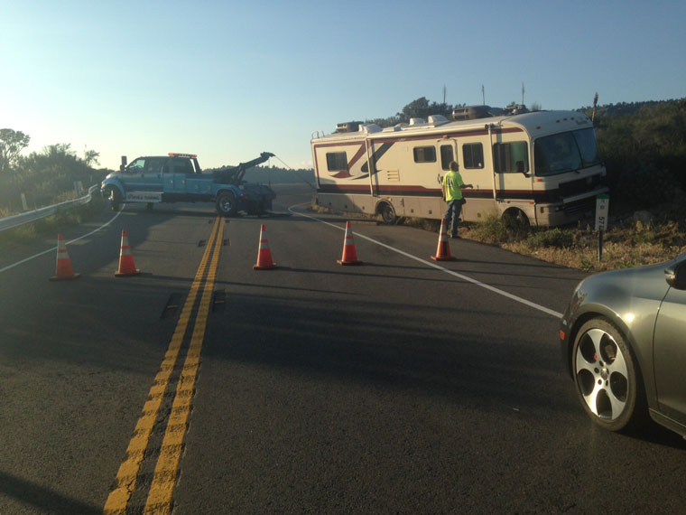 On Monday, June 8, around 6 p.m., a large RV reportedly lost brakes and crossed the yellow line, careening into and lodging against the side of the mountain just south of Mountain Center. Photo by Suzanne Avalon