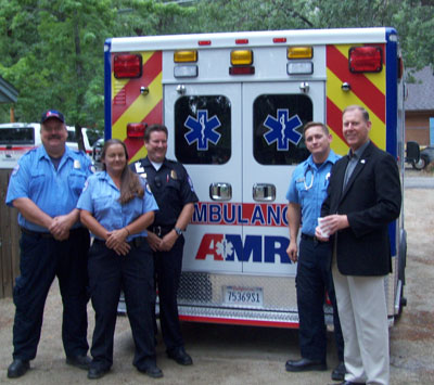 New Pine Cove ambulance On Wednesday morning, July 1, American Medical Response had crews ready to provide ambulance service to Pine cove residents. The AMR officials and crews are (from left) Mack Blanton, medic; Kim Brown, emergency medical technician; Jim Plamer, operations supervisor and medic; Karl Schmidt, medic; and Douglas Keys, AMR general manager for Riverside County. Photo by Jerry Holldber