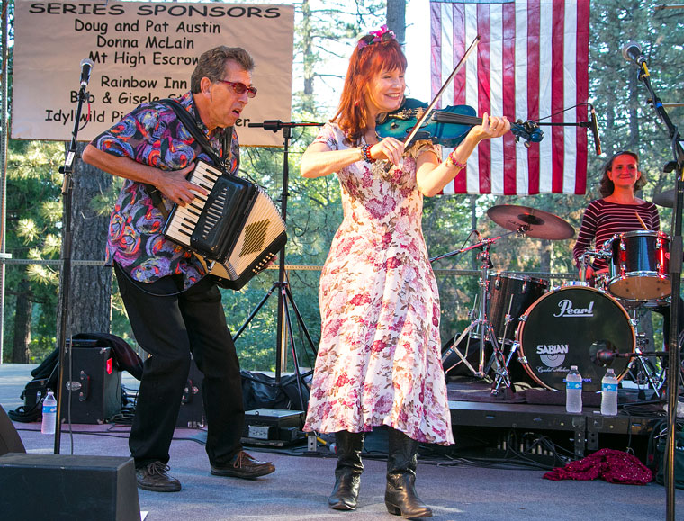 Lisa Haley plays her famous blue fiddle Thursday during the first concert of the annual Idyllwild Summer Concert Series. The concerts are at the Idyllwild Community Park.                                                      Photo by Jenny Kirchner