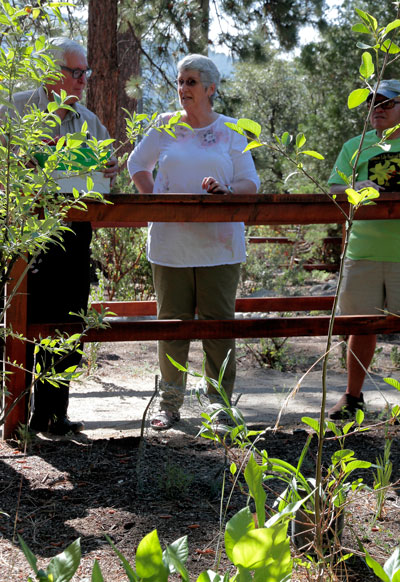 Maureen McElligot (center) with Nature Center volunteer Scott Fisher (left) and Master Gardener Bill Bair (right) opened this year's Lemon Lily Festival with a blessing for the native Lemon Lily Saturday morning. Photo by John Drake