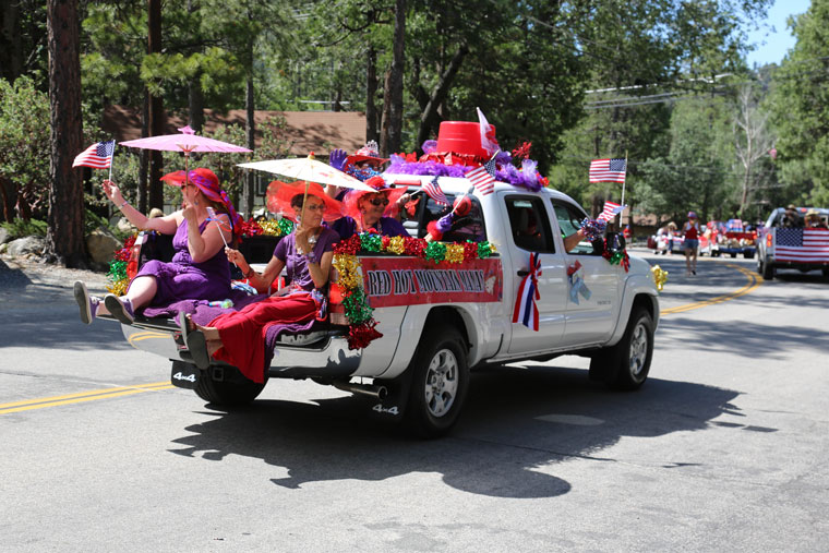 The Red Hot Mountain Mamas, a part of the Red Hat Society, were one of the most colorful groups in Saturday's holiday parade. Photo by Cheryl Bayse