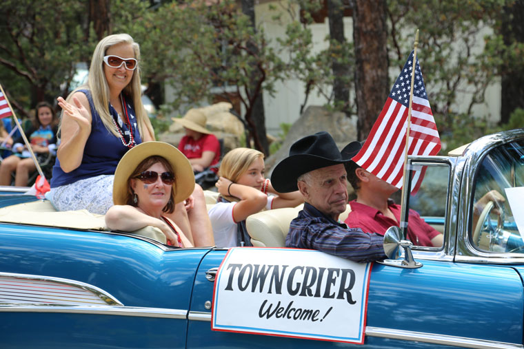 Wendy Read (left) was voted the 2015 Ernie Maxwell Community Spirit Volunteer of the Year. Accompanying Read is her daughter Shelby (center) and Becky Clark, Town Crier co-owner and co-publisher. Don Parker drove Read in his 1957 Chevy Bel Air, accompanied by his father-in-law, Bob Krone, son of Max and Bea Krone. Photo by Cheryl Bayse