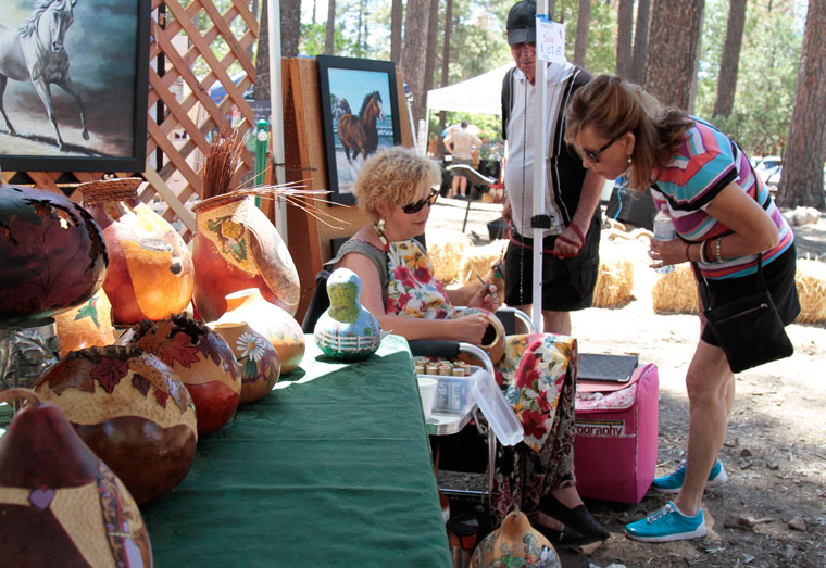 2nd Saturday draws a crowd Linda M. Spear of Simply Unique decorates her gourds with hand-painted art during the 2nd Saturday art event at the Idyllwild Community Park last weekend. Photo by John Drake