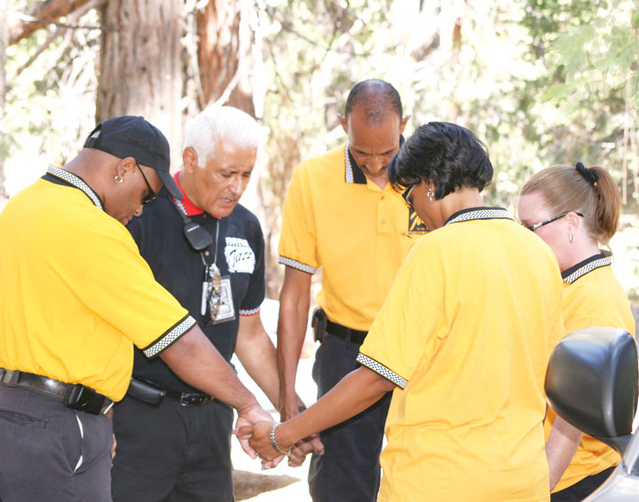 Saturday morning before any music started at the 2008 Jazz in the Pines festival, Alex Vagas (second from left) led his stage crew in a brief prayer. When they finished, the chaos of moving acts on and off the stage became nearly non-stop until Sunday evening. FILe photo