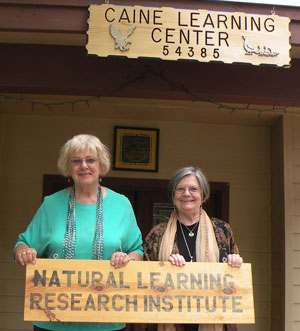 """Renate Caine and Carol McClintic in front of the Caine Learning Center, the site for the """"Aging Gracefully"""" dialogue on Aug.11, in the meeting room. Photo by Sally Hedberg"""