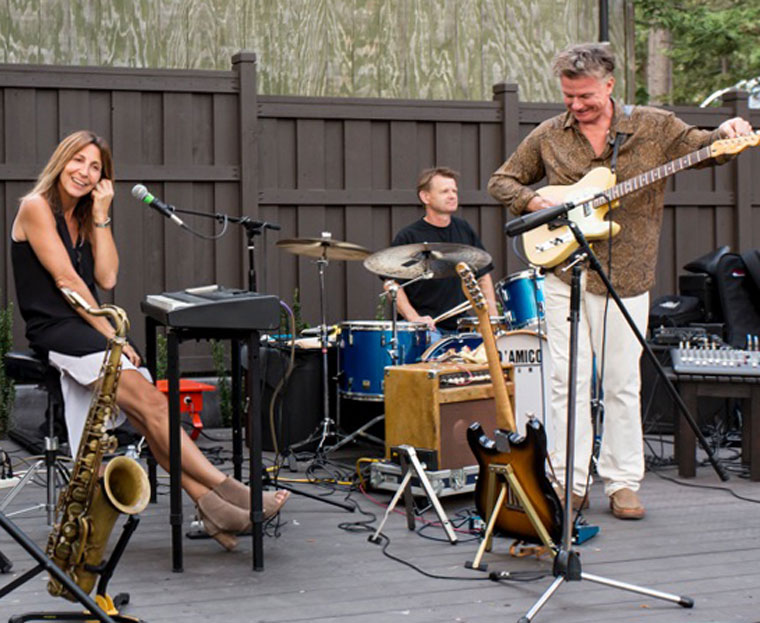 From left, Deanna Bogart on sax, Jeff Olson on percussion, Don Reed on guitar and Bill Saitta (not shown) on bass perform at Ferro Friday evening. Photo by Peter Szabadi