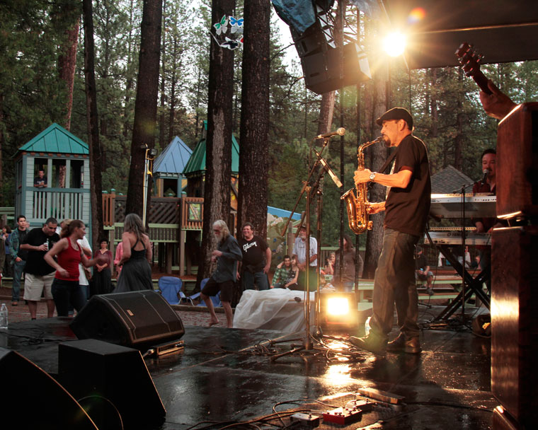 Despite rain, a wet stage and soaked chairs, the fun and joy of another Idyllwild Summer Concert, this one featuring Grupo Bohemio, takes place Thursday evening. Photo by John Drake