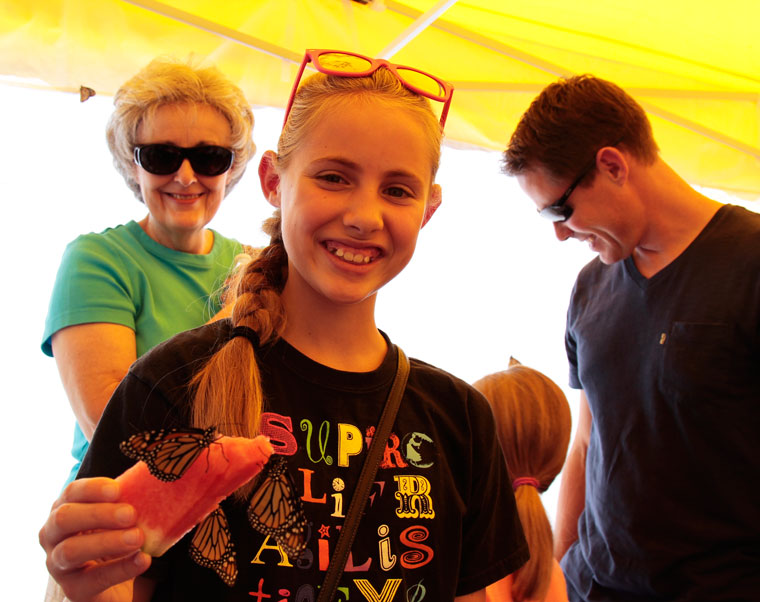 Emma Rohrer enjoys the company of butterflies at the annual Butterfly Daze presented at the Idyllwild Nature Center. She is with her Grandmother, Marylyn Mook, and Gather Steve.Photo by John Drake