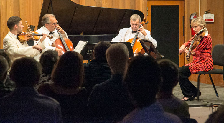 """Stirling Trent, violin, David Speltz, cello, John Walz, cello and Connie Kupka, viola, perform """"Variations on a Theme by Tchaikovsky"""" from String Quartet No. 2 in A minor, Op. 35 Wednesday night at Stephens Recital Hall at Idyllwild Arts. Photo by Jenny Kirchner"""