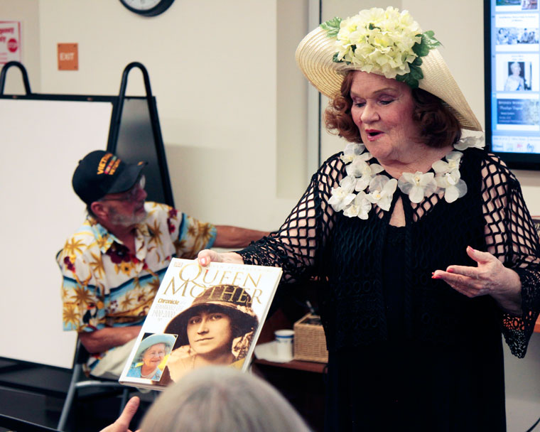 """Penelope Engard offers a view of her favorite books on the Queen Mum, Mother of Queen Elizabeth II, the subject of Monday's historical lecture at the library and part of Engard's series, """"Spoken Words.""""Photo by John Drake"""