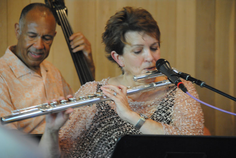 Holly Hoffman, jazz flautist, entertained the Stephens Hall crowd Sunday afternoon. Joining her and Mike Wofford was John Clayton on bass in background. Photo by JP Crumrine