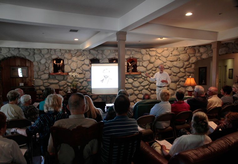 Bob Smith shows slides of his own extensive family history in Idyllwild at the Idyllwild Area Historical Society's annual meeting Sunday, Aug. 9, at the Creekstone Inn. Photo by John Drake