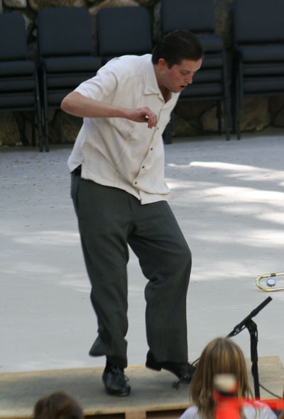 Justin Holmes of Idyllwild and a 2001 Idyllwild Arts Academy graduate, tap dances to Casey Abrams' band on the main stage in the Holmes Amphitheatre (named for his grandfather, Robert Holmes), on Sunday while a gaggle of little girls watches. Photo by Jack Clark