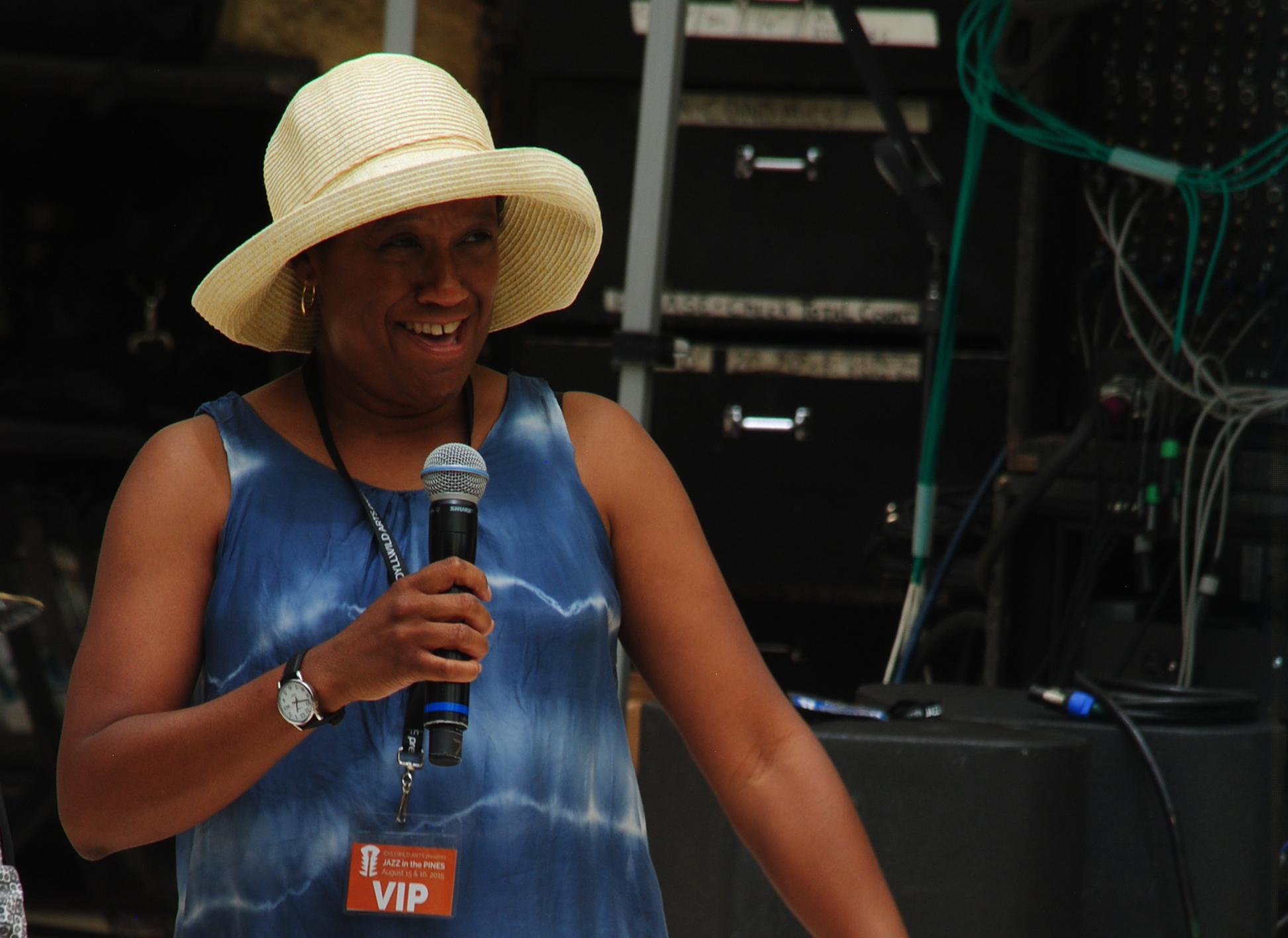 Below, Idyllwild Arts President Pamela Jordan talks to the crowd at the Main Stage. Photo by JP Crumrine