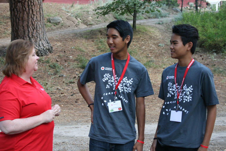 Lois Beckman, American Red Cross executive director for Riverside County and Morongo Basin (left), is seen here with Red Cross campers at Idyllwild Pines, Joseph Nguyen (center) and Ryan Neis. Both campers assisted with installing smoke alarms in Idyllwild residences as part of the Red Cross campaign to prevent home fires. Photo by Marshall Smith