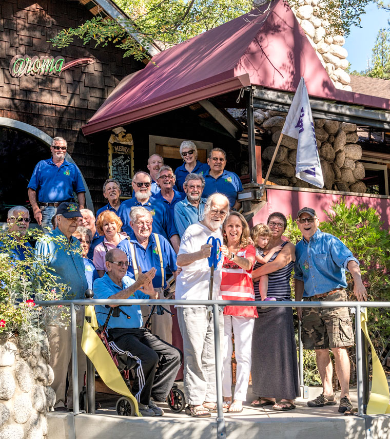 Cafe Aroma owner Hubert Halkin (front, center) and wife Kathy are seen moments after cutting the ribbon denoting new areas and improvements at the local eatery. They are surrounded by Idyllwild Rotary representatives, organizers of the local ribbon-cutting ceremonies.Photo by Philip Weber
