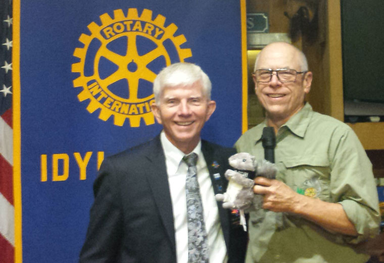 Rotary District Governor Rudy Westervelt (left) was the speaker last week at Idyllwild Rotary. Rudy discussed the Rotary World Peace Conference in Ontario, California Jan. 15 to 16, 2016. President Chuck Weisbart gifts the speaker with a stuffed squirrel. Photo by Nathan DePetris