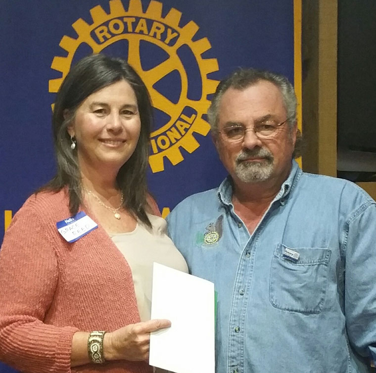 Wednesday, Aug. 19, the Idyllwild Rotary Club member Joe Mattioli thanked Grace Reed for her tireless work to help make the Fourth of July Street Festival a huge success. Photo courtesy Rotary Club