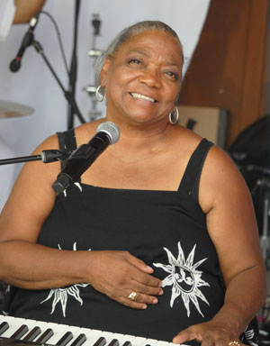 The popular Yve Evans attracted a full house to the French Quarter Sunday afternoon to hear her commentary and performance.Photo by JP Crumrine