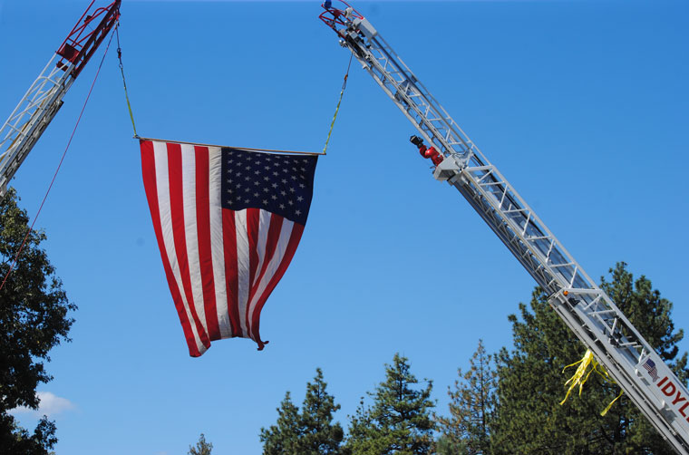 U.S. flag flying over Hwy 243 during the 9-11 Ceremony and then all day in memory of the tragedy. Photos by JP Crumrine