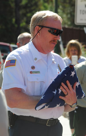 Idyllwild Fire Chief Patrick Reitz prepares to have the flag raised to concluded the 9-11 ceremony.