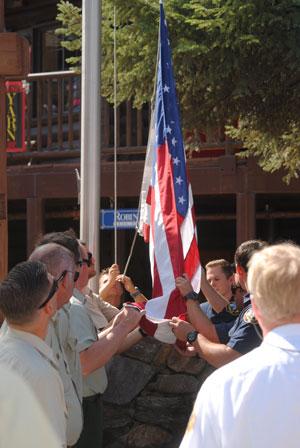 Raising the flag in memory of the tragic Sept. 11, fourteen years ago.