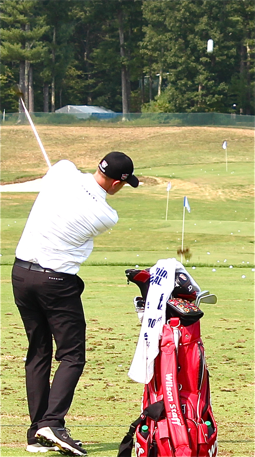 Brendan Steele on the practice tee at the Deutsche Bank. Photo by André Pilon