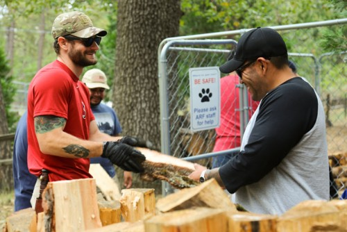 """Steven Rich (red) and George Hernandez (Blk/Grey) box wood at ARF last Saturday. They are two of 34 class participants from the Pasadena City College known as """"Boots to Books."""" For the fifth year, the class came to Idyllwild to volunteer at ARF. The class integrates newly discharged military veterans to the challenges of civilian life, college and personal development. Photo by Cheryl Basye"""